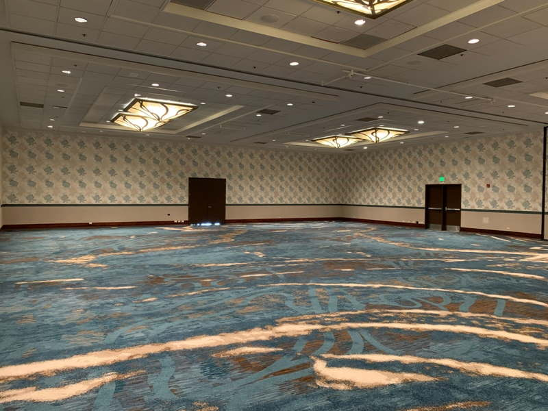 Pacific Ballroom, a large ballroom with high ceilings and blue carpet