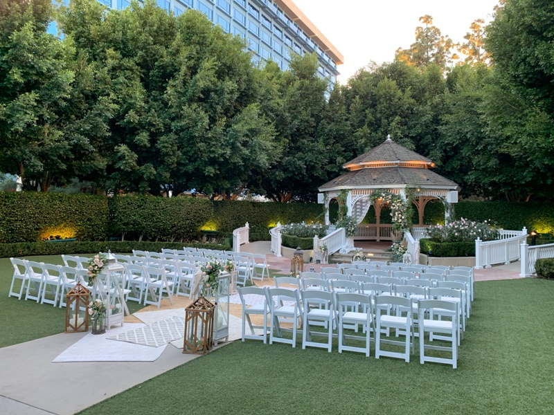 Rose Court Garden decorated with white flowers and greenery for a wedding ceremony