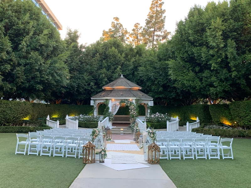 Rose Court Garden with white gazebo and white ceremony chairs placed in rows