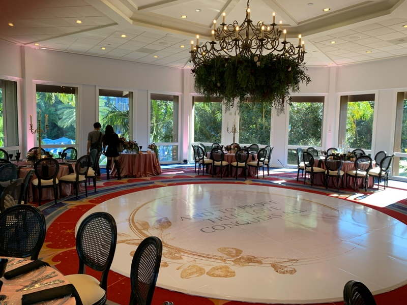 Sleeping Beauty Pavilion round ballroom with circular white dance floor and round tables with black chairs