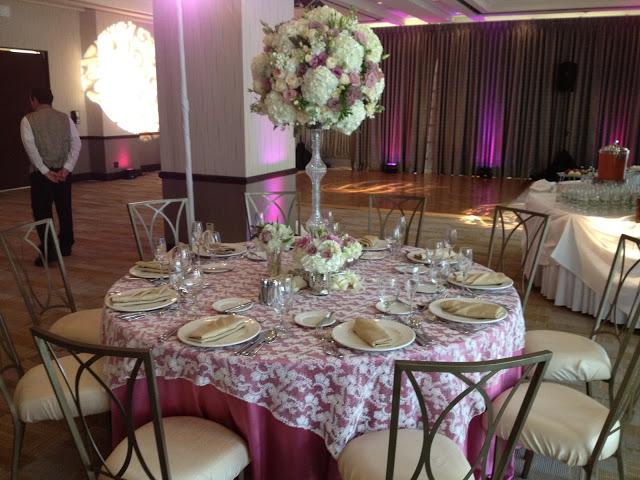 Decorated wedding reception table inside Mark Twain Room